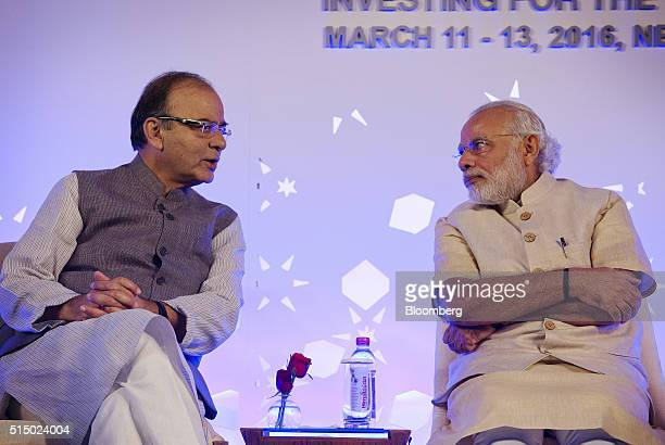 Arun Jaitley India's finance minister left speaks with Narendra Modi India's prime minister at the Advancing Asia Conference in New Delhi India on...