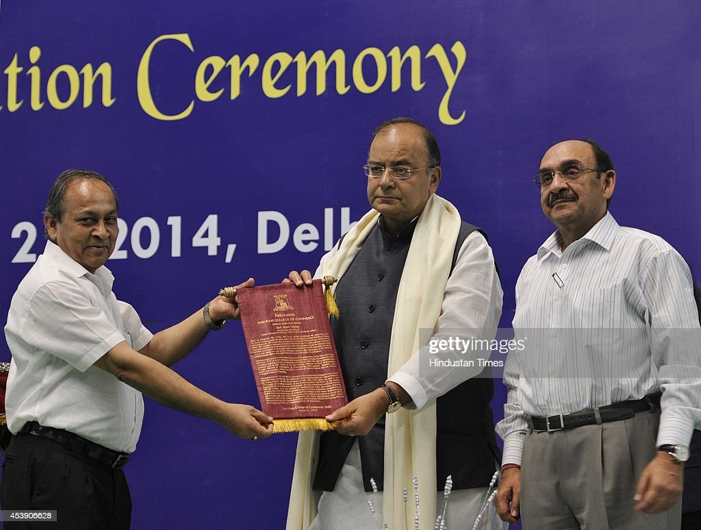 Arun Jaitley, Union Minister for Finance, Defence and Corporate Affairs being felicitated by the principal of the college PC Jain as Ajay S Shriram, president CII, looks on at his felicitation ceremony at Shri Ram College of Commerce in North Campus on August 21, 2014 in New Delhi, India. Jaitley said that the govt was working to tighten up risk management in the banking sector.