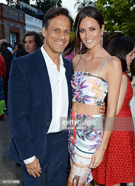 Arun Nayar and Kim Johnson attend The Serpentine Gallery Summer Party cohosted by Brioni at The Serpentine Gallery on July 1 2014 in London England