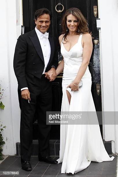 Arun Nayar and Liz Hurley depart home for Elton John's Party on June 24 2010 in London England