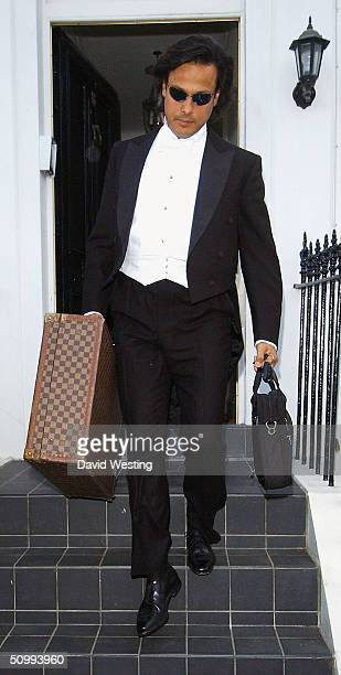 Arun Nayar leaves girlfriend Elizabeth Hurley's London home to attend the 'White Tie Tiara Ball' hosted by Sir Elton John at his Berkshire mansion on...