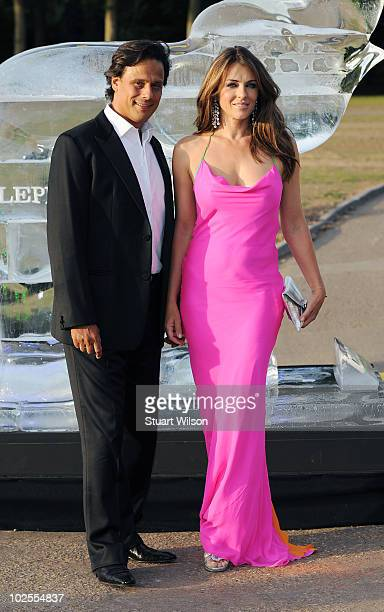 Arun Nayer and Liz Hurley attend The Elephant Parade auction in aid of The Elephant Family at Royal Hospital Chelsea on June 30 2010 in London England