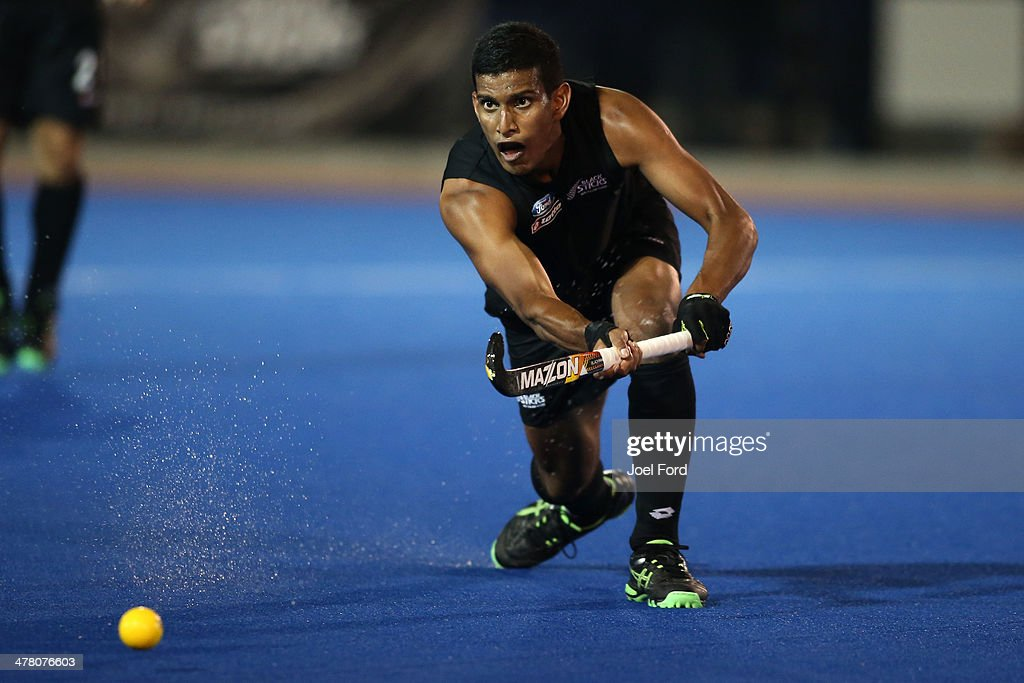 Arun Panchia of New Zealand passes the ball during the Test Match between the New Zealand Black Sticks and Japan at Blake Park on March 12, 2014 in Mount Maunganui, New Zealand.