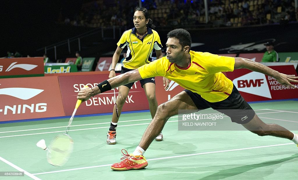 Arun Vishnu and Aparna Balan from India play against Michael Fuchs and Birgit Michels (not in picture) from Germany during their match at the 2014 BWF Badminton World championships held at the Ballerup Super Arena in Copenhagen on August 26, 2014.
