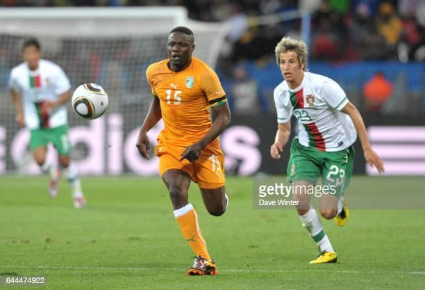 Aruna DINDANE / Fabio COENTRAO Cote d'Ivoire / Portugal Coupe du Monde 2010 Match 13 Groupe G Nelson Mandela Bay Stadium Port Elizabeth Afrique du...