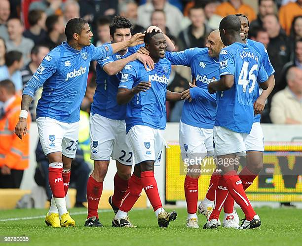 Aruna Dindane of Portsmouth celebrates scoring their first goal during the Barclays Premier League match between Portsmouth and Wolverhampton...