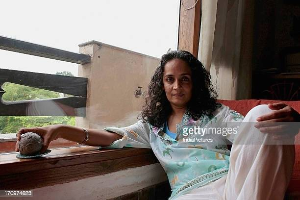 Arundhati Roy celebrated writer activist and winner of the Booker Prize for the book 'God of Small Things' at her home in Delhi India