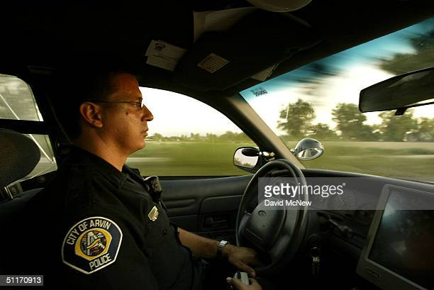Arvin police officer Phil Bebabides responds to calls on August 13 2004 in the town of Arvin southeast of Bakersfield California Unlike other nearby...