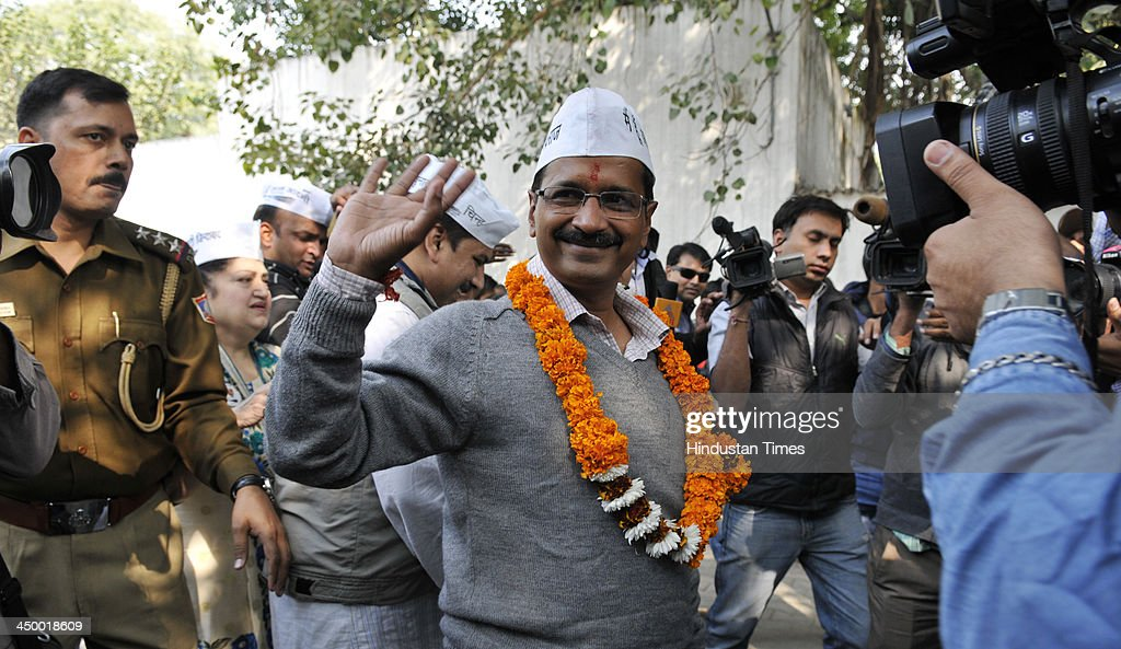 Arvind Kejriwal Aam Admi Party candidate for New Delhi assembly constituency waves to his supporters after filing his nomination papers for 5th Legislative Assembly Elections at DC office Jamnagar House on November 16, 2013 in New Delhi, India. The New Delhi constituency will witness a triangular contest between Delhi Chief Minister Sheila Dikshit, Bharatiya Janata Partys Vijender Gupta and Kejriwal.