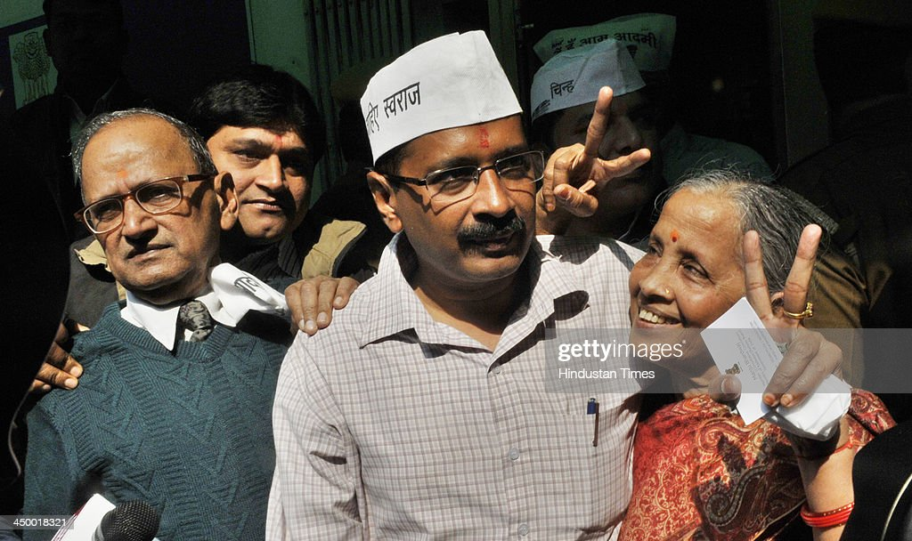 Arvind Kejriwal Aam Admi Party candidate for New Delhi assembly constituency with his parents after filing his nomination papers for 5th Legislative Assembly Elections at DC office Jamnagar House on November 16, 2013 in New Delhi, India. The New Delhi constituency will witness a triangular contest between Delhi Chief Minister Sheila Dikshit, Bharatiya Janata Partys Vijender Gupta and Kejriwal.