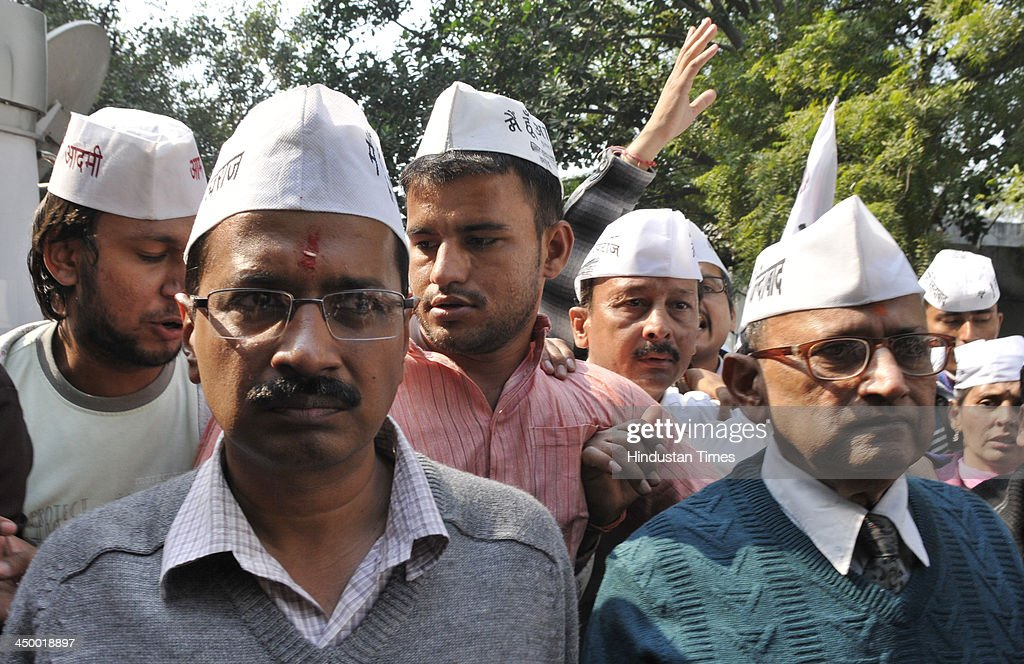 Arvind Kejriwal Aam Admi Party Chief Ministerial Candidate and candidate for New Delhi assembly constituency with his father arrives to file his nomination papers for 5th Legislative Assembly Elections at DC office Jamnagar House on November 16, 2013 in New Delhi, India. The New Delhi constituency will witness a triangular contest between Delhi Chief Minister Sheila Dikshit, Bharatiya Janata Partys Vijender Gupta and Kejriwal.