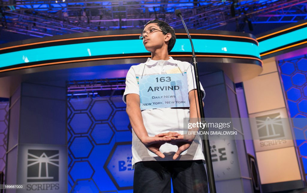 Arvind V Mahankali representing New York cracks his knuckles after correctly spelling the winning word during the championship round at the Scripps...
