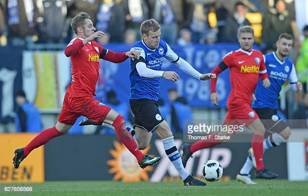 Arvydas Novikovas of Bochum tackles Brian Behrendt of Bielefeld during the Second Bundesliga match between DSC Arminia Bielefeld and VfL Bochum 1848...