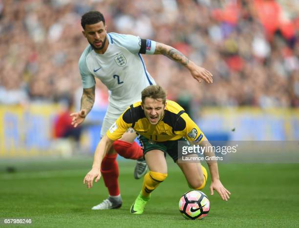 Arvydas Novikovas of Lithuania battles for the ball with Kyle Walker of England during the FIFA 2018 World Cup Qualifier between England and...
