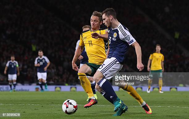 Arvydas Novikovas of Lithuania vies with Andy Robertson of Scotland during the FIFA 2018 World Cup Qualifier between Scotland and Lithuania at...