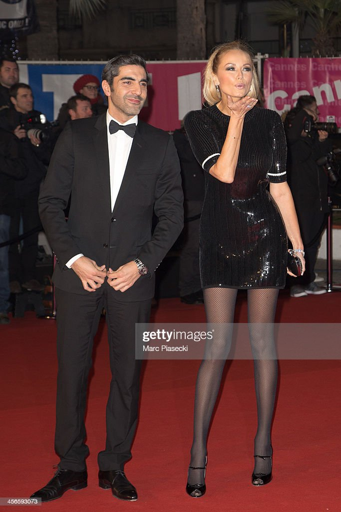 Ary Abittan and Adriana Karembeu attend the 15th NRJ Music Awards at Palais des Festivals on December 14, 2013 in Cannes, France.