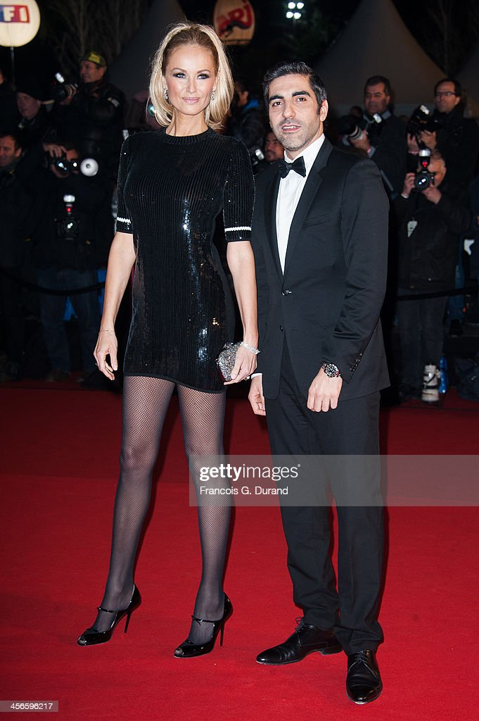 Ary Abittan and <a gi-track='captionPersonalityLinkClicked' href=/galleries/search?phrase=Adriana+Karembeu&family=editorial&specificpeople=207098 ng-click='$event.stopPropagation()'>Adriana Karembeu</a> attend the 15th NRJ Music Awards at Palais des Festivals on December 14, 2013 in Cannes, France.