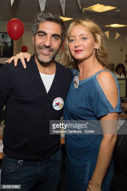 Ary Abittan and Julie Ferrier attend the Aurel BCG Charity Benefit Day 2017 on September 11 2017 in Paris France