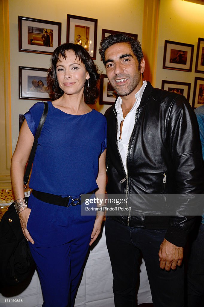 Ary Abittan (R) poses with Mathilda May after his performance at Theater Edouard VII benefiting 'Un Coeur Pour La Paix' on June 24, 2013 in Paris, France.