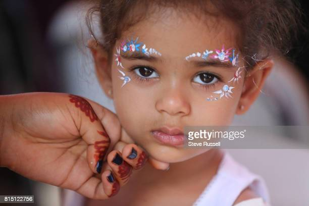 TORONTO ON JULY 15 Arya Patel gets painted with GopiDots floral designs painted above the eyebrows and down the sides of the eyes They are named...