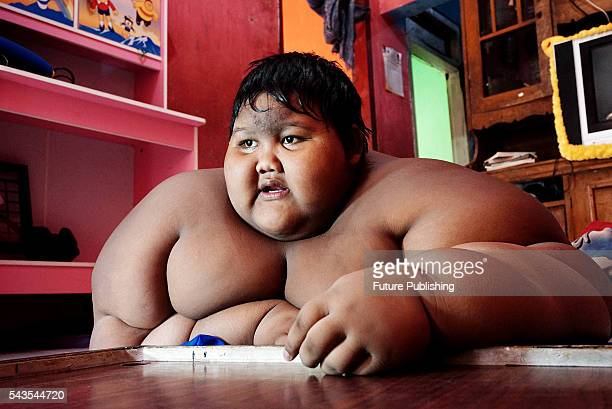 Arya Permana 10yearold who weights 192 kilograms playing game in his home on June 13 2016 in West Java Indonesia A 10YEAROLD from Indonesia has...