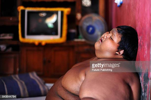 Arya Permana 10yearold who weights 192 kilograms sleeping in his home on June 13 2016 in West Java Indonesia A 10YEAROLD from Indonesia has weighed...
