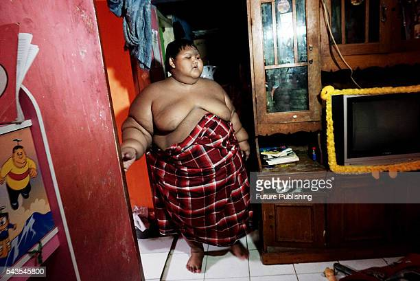 Arya Permana 10yearold who weights 192 kilograms walk in his home on June 13 2016 in West Java Indonesia A 10YEAROLD from Indonesia has weighed in at...