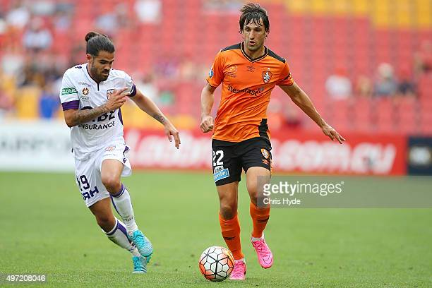 Aryn Williams of the Glory and Thomas Broich of the Roar compete for the ball during the round six ALeague match between Brisbane Roar and Perth...