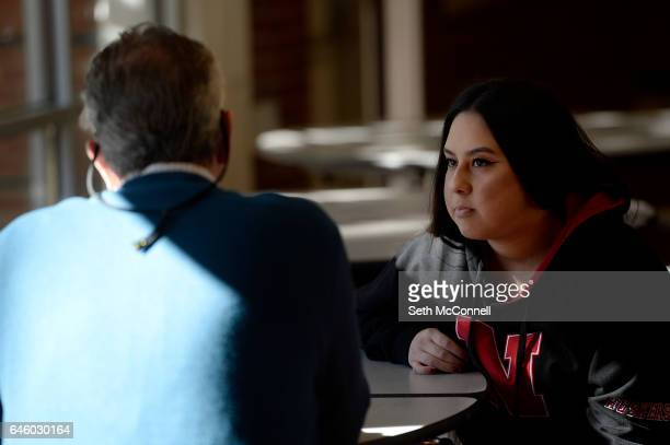 Aryssa Guzman talks with Rob Tallmadge during a mentoring session at Jefferson High School in Edgewater Colorado on February 22 2017 Goodwill Youth...
