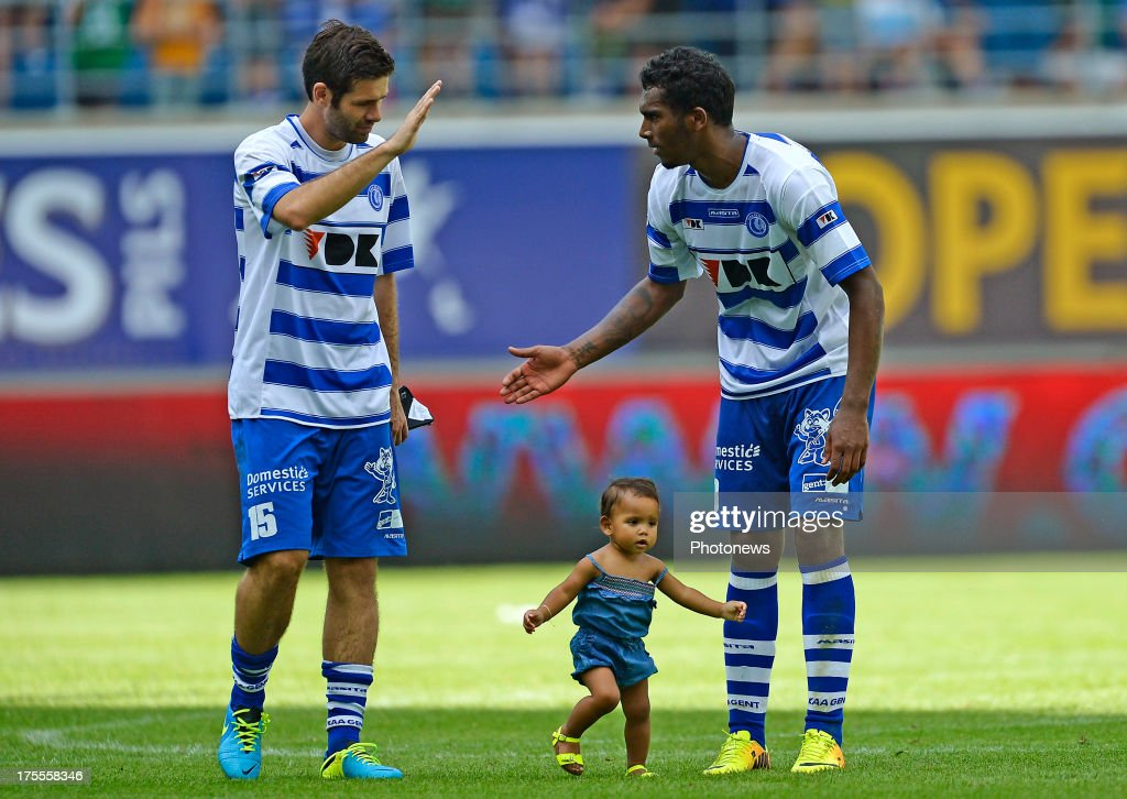 Arzo Amposta Cesar of KAA Gent shakes hands after the victory with Renato Neto of KAA Gent with his daughter after the Jupiler League match between KAA Gent and KV Mechelen on August 04, 2013 in the Ghelamco stadium Gent, Belgium. (Photo by Nico Vereecken / Photonews