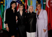 Andrea Jung Chairman and CEO Avon Products actress and Avon Global Ambassador Reese Witherspoon UNIFEM Executive Director Joanne Sandler and...