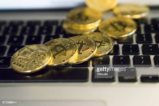 As a visual representation of the digital Cryptocurrency Bitcoin physical tokens are placed on the Apple Mac Book Pro on October 24 2017 in Hong Kong...