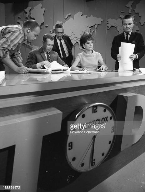 As aides prepare their scripts American broadcast journalists Hugh Downs and Barbara Walters sit at the desk on the 'Today' show set New York New...