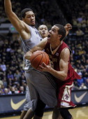 As AJ Hammons of the Purdue Boilermakers guards Ryan Anderson of the Boston College Eagles makes a move to the basket at Mackey Arena on December 4...