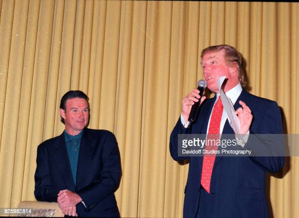 As American retired tennis player Jimmy Connors listens American real estate developer Donald Trump during an event at the MaraLago Club Palm Beach...
