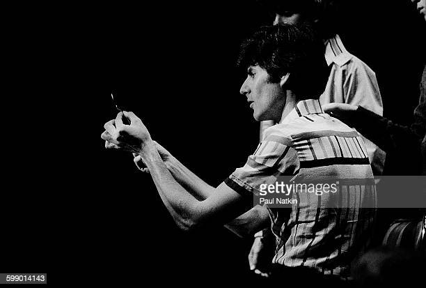 As audience members watch Israeli popular entertainer Uri Geller performs illusions onstage at the Park West Chicago Illinois August 25 1979