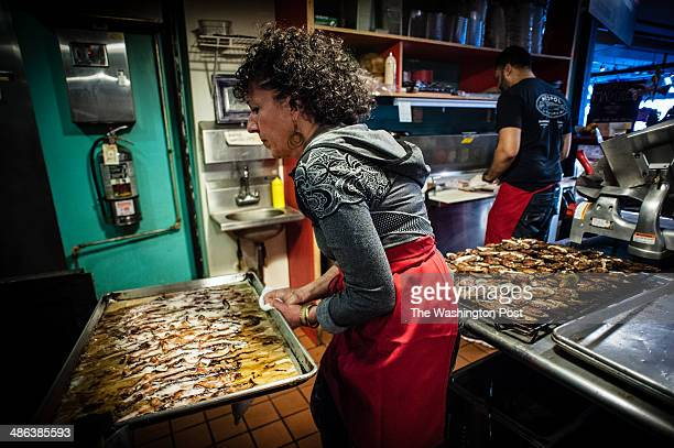 As Barbara pulls a tray of bacon which they cure inhouse Dorian makes a sandwich for a customer Barbara Lahnstein and her son Dorian Brown own Neopol...