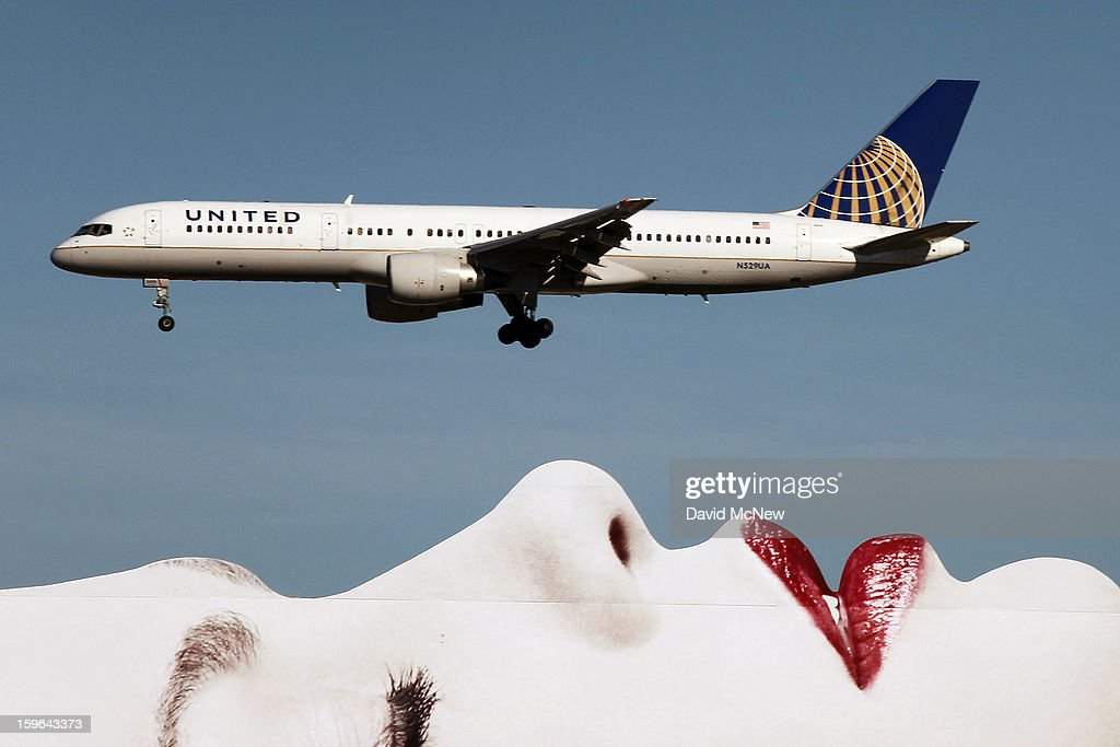 As Boeing 787 Dreamliner jets operated by United Airlines and other carriers are grounded, a United Airlines 757 passes a billboard on approach to Los Angeles International Airport (LAX) on January 17, 2013 in Los Angeles, California. The Federal Aviation Administration has grounded all U.S.-registered Boeing 787 Dreamliner jets for the repair of batteries believed to be linked to a fire risk following a number of related 787 aircraft incidents this month.