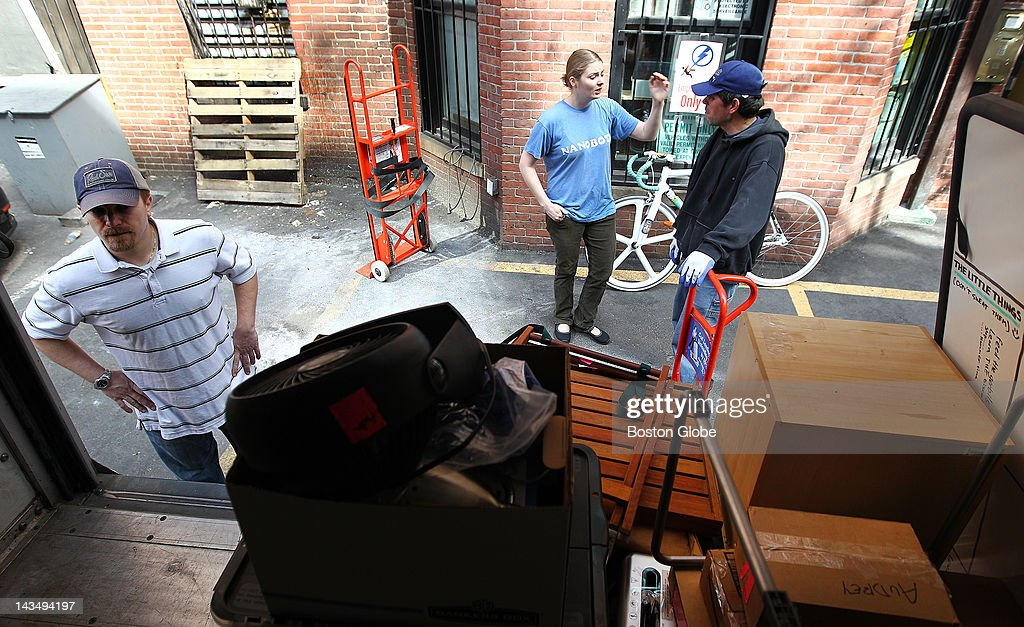 As bookkeeper Audrey Knuth, center, gives directions to mover Jenti Cezmaxhi, senior corporate account manager Joshua Brzuchalski surveys the items loaded in the truck. With the help of movers, employees of Tech Superpowers pack up their office at 252 Newbury Street to move to 29 Stanhope Street in Boston, on Thursday, April 26, 2012.