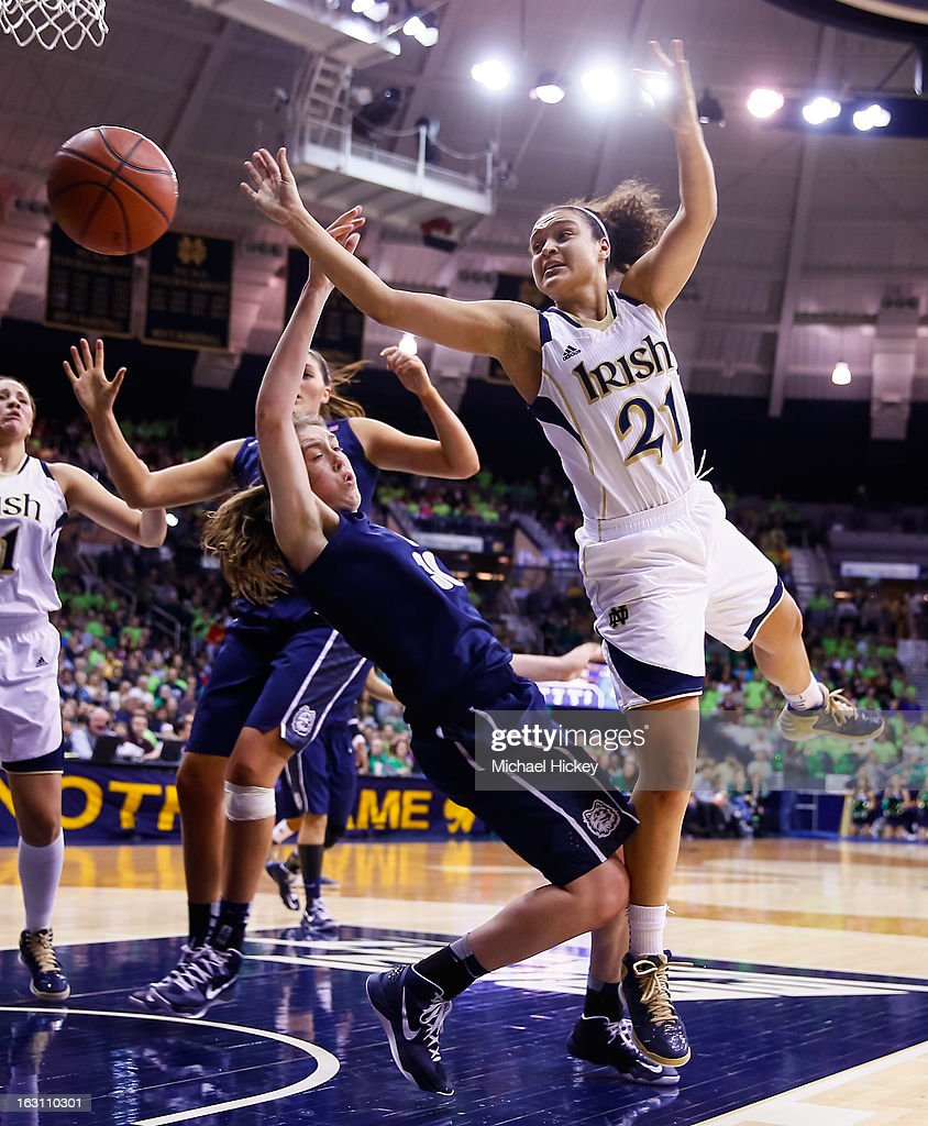 As Breanna Stewart #30 of the Connecticut Huskies fouls Kayla McBride #21 of the Notre Dame Fighting Irish loses the handle on the ball at Purcel Pavilion on March 4, 2013 in South Bend, Indiana. Notre Dame defeated Connecticut 96-87 in triple overtime to win the Big East regular season title.