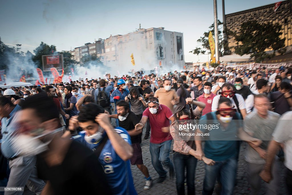 As clashes turn violent demonstrators run from the police As the police attempt to clear Taksim square violence breaks out on June 11th 2013 After...