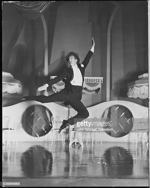 As dancer Bunny Billings Ray Bolger leaps through the air on stage in the 1941 remake Sunny