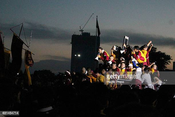 GRANDSTAND MANILA NCR PHILIPPINES As dawn approaches more devotees clamber on to one another to get a chance to kiss the Icon of the Black Nazarene...