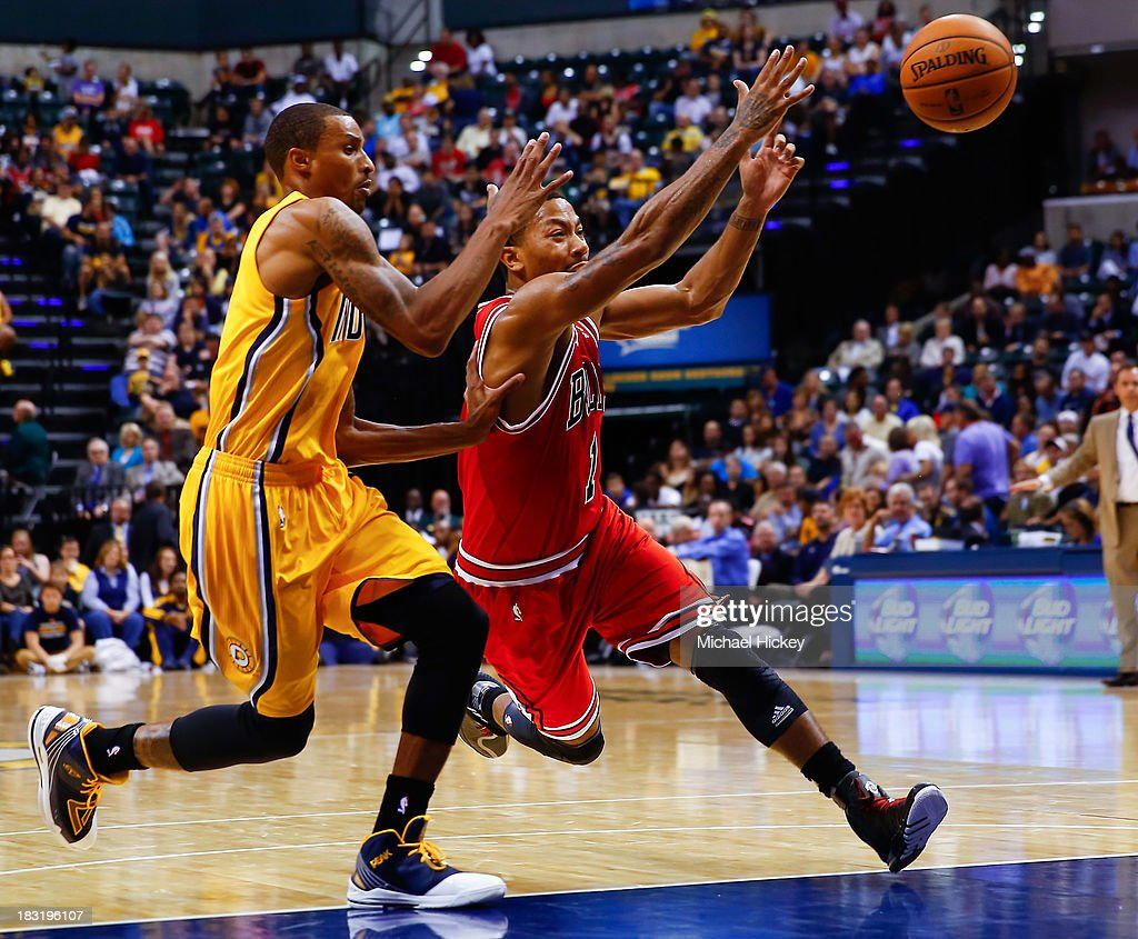 As George Hill #3 of the Indiana Pacers defends <a gi-track='captionPersonalityLinkClicked' href=/galleries/search?phrase=Derrick+Rose&family=editorial&specificpeople=4212732 ng-click='$event.stopPropagation()'>Derrick Rose</a> #1 of the Chicago Bulls loses the handle on the ball on October 5, 2013 at Bankers Life Fieldhouse in Indianapolis, Indiana. Chicago defeated Indiana 82-76.