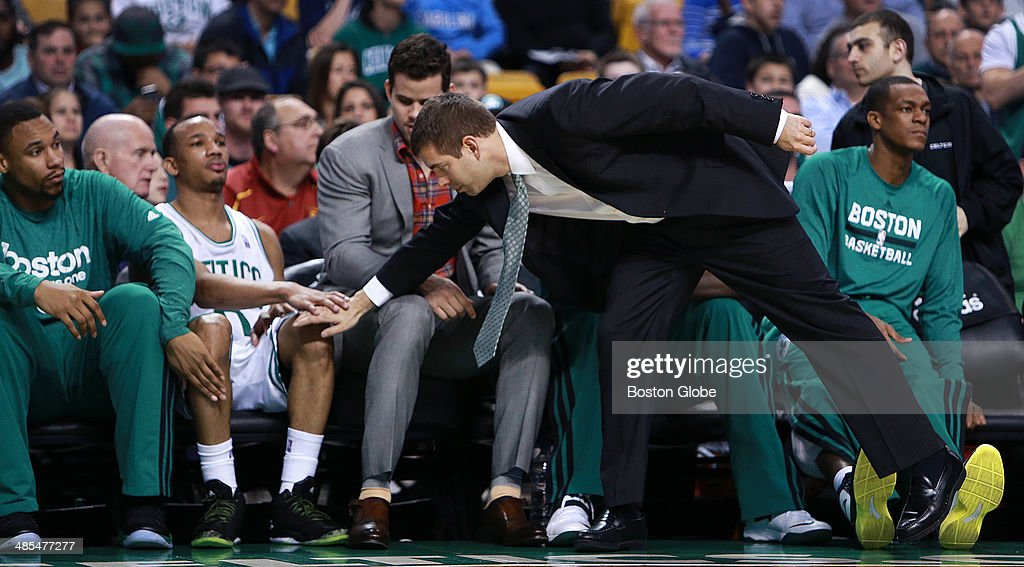 As he comes out of the game for the final time this season, the Celtics' Avery Bradley gets a pat from head coach Brad Stevens, as well as teammate Jared Sullinger, far left. Also pictured are Kris Humphries and Rajon Rondo, far right. The Boston Celtics hosted the Washington Wizards in their final NBA game of the season at the TD Garden on Wednesday, April 16, 2014.
