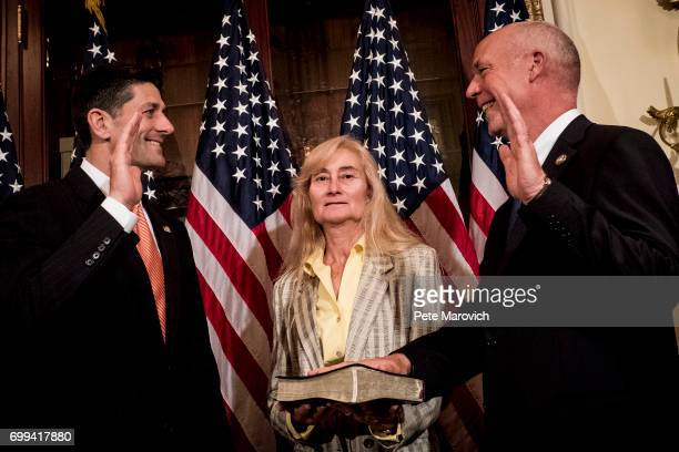 As his wife Susan holds the bible controversial Montana Republican Greg Gianforte is ceremonially sworn in by Speaker of the House Paul Ryan RWis on...