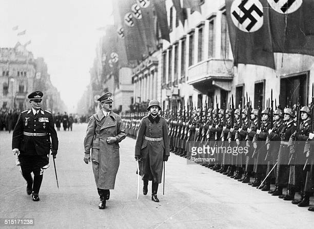 As Hitler Returned in Triumph to Berlin Berlin Germany Chancellor Adolf Hitler accompanied by Marshal Hermann Goering inspecting honor troops lined...