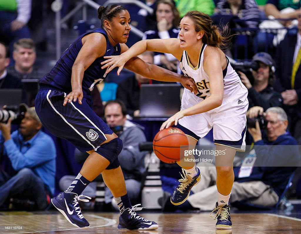 As Kaleena Mosqueda-Lewis #23 of the Connecticut Huskies guards Michaela Mabrey #23 of the Notre Dame Fighting Irish dribbles the ball at Purcel Pavilion on March 4, 2013 in South Bend, Indiana. Notre Dame defeated Connecticut 96-87 in triple overtime to win the Big East regular season title.