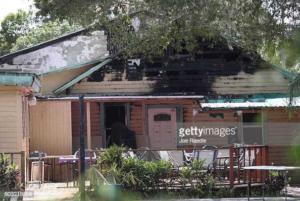 As Law enforcement officials investigate a fire at the Islamic Center of Fort Pierce part of a burnt wall is seen at the mosque that was attended by...