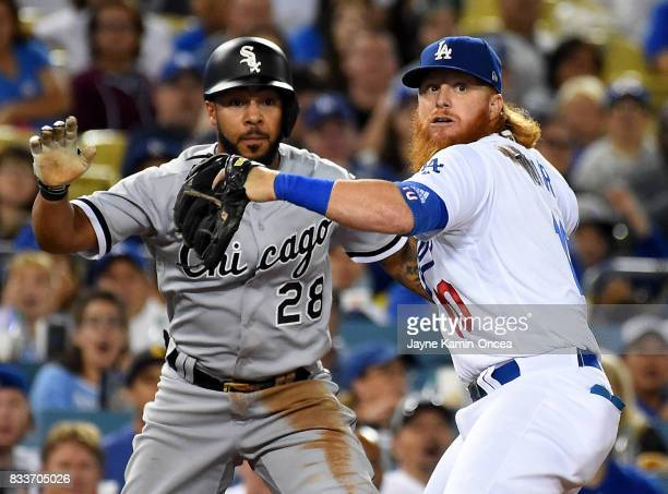 As Leury Garcia of the Chicago White Sox stays on the bag at third Justin Turner of the Los Angeles Dodgers catches a line drive off Adam Engel of...